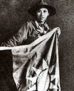 A girl scout, Yang Huimin, smuggled a Nationalist flag into a Shanghai warehouse besieged by Japanese forces in 1937. (Courtesy Wikipedia.)