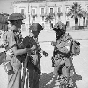 Two British soldiers and an American paratrooper, Avola, Sicily, July 1943 (Courtesy Wikimedia Commons)