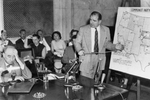 The Army-McCarthy hearings, 1954. McCarthy stands at right; Joseph Welch, opposing counsel, seated, left. (Courtesy U. S. Senate Historical Office)