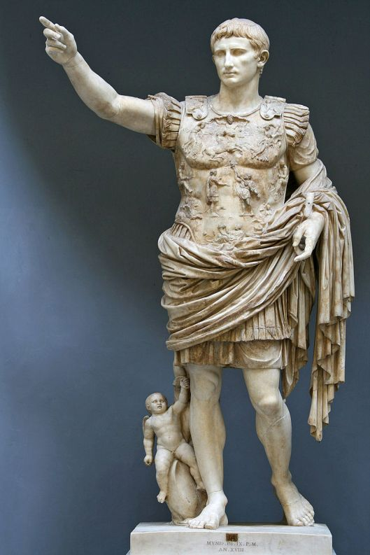 The so-called Prima Porta statue of the Emperor Augustus, 1st century CE, now in the Vatican. Note the martial attire and the baby, probably an image of Romulus, the city's legendary founder (Courtesy Wikimedia Commons).