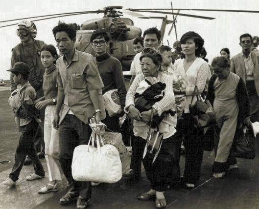 Operation Frequent Wind, 29 April 1975. As Saigon fell, some Vietnamese civilians were evacuated to U.S. Navy vessels, as here, and granted asylum (Courtesy Wikimedia Commons via U.S. Marines; public domain)