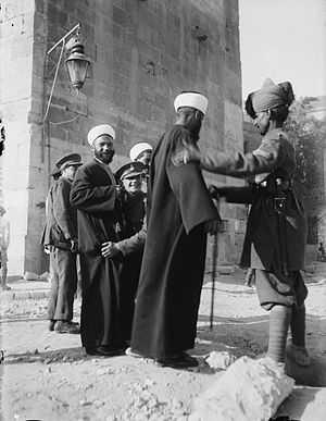 British soldiers search Arabs during anti-Jewish pogroms, April 1920 (Courtesy Wikimedia Commons).