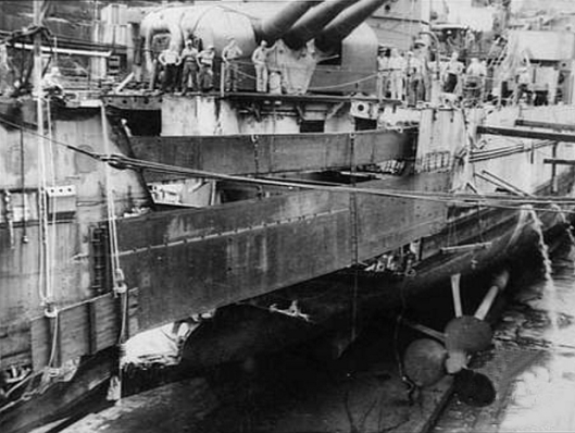 Cruiser U.S.S. Portland in dry dock for repairs in Australia after a naval battle off Guadalcanal, 1942 (Courtesy Australian War Memorial via Wikimedia Commons)