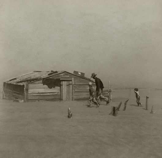 A farmer and his two sons brave a dust storm in Cimarron County, Oklahoma, 1936; Arthur Rothstein, Farm Security Administration (courtesy Library of Congress via Wikimedia Commons)